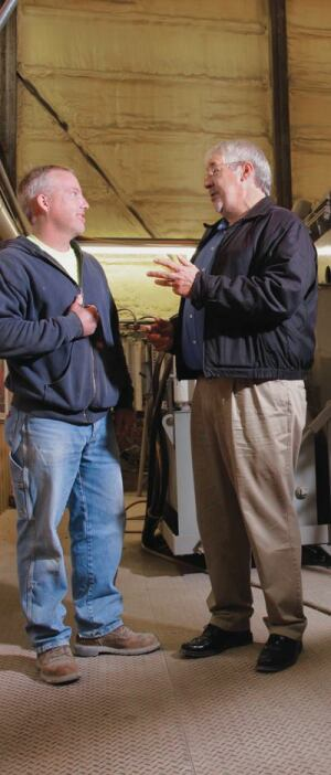 Dan Shetterley (left), co-manager at Irving Materials Inc.'s Post Road plant in Indianapolis, talks with Jerry Larson.
