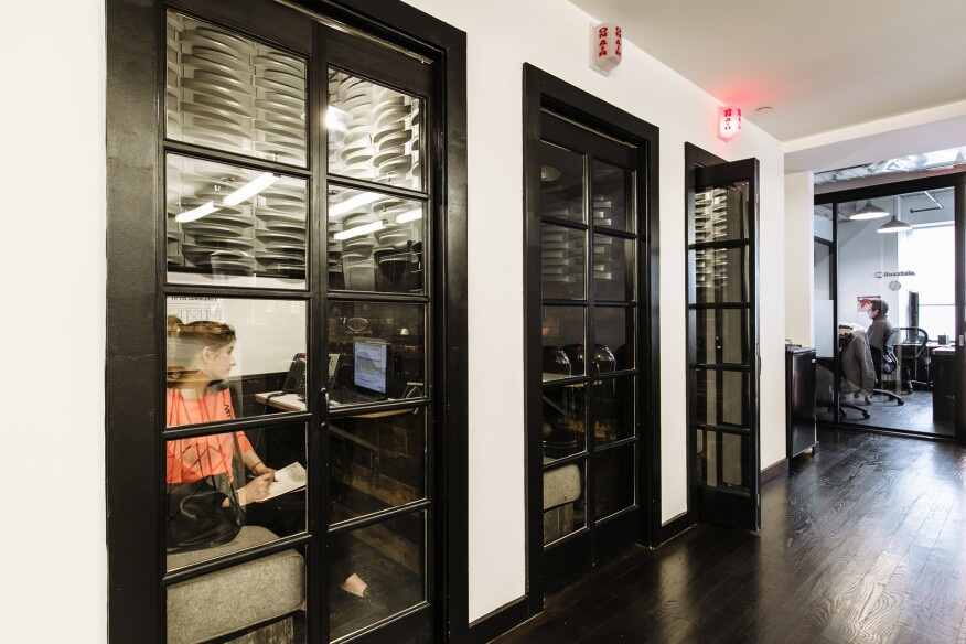 Phone booths, available on a first come, first served basis, give WeWork members privacy.