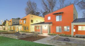 Bright exterior colors contribute to the project's cheerful atmosphere, while sloped roofs bestow a bit of high-ceilinged grandeur on the interior spaces. Each of the six townhouses accomodates four families, and an additional structure holds day-care and