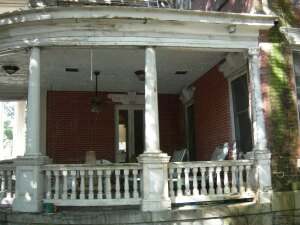 BEFORE: Failure of the original concealed gutters led to extensive damage, including at the curved cornice of the verandah roof.