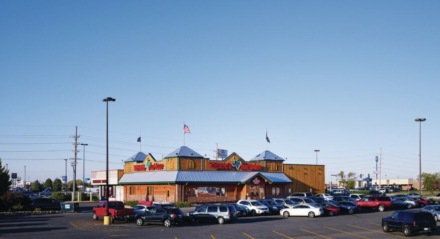 The GreenbergFarrow-designed Texas Roadhouse in Bradley, Ill., is an attached version of the typology.