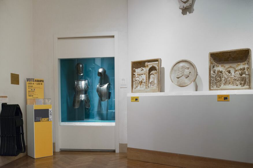 A side-by-side LED lamp test in one of the museum's galleries.