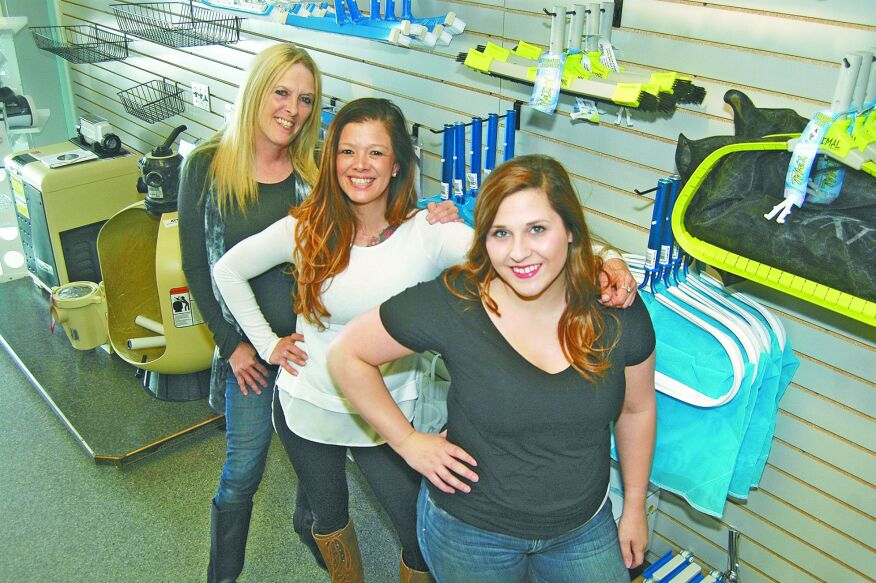 Left to right, Lesa Angleton with two of her daughters, April Harris, center, and Heather Angleton, in the newly opened location for their pool and spa service and retail store Pool Medics Rx in Derby, Kan.