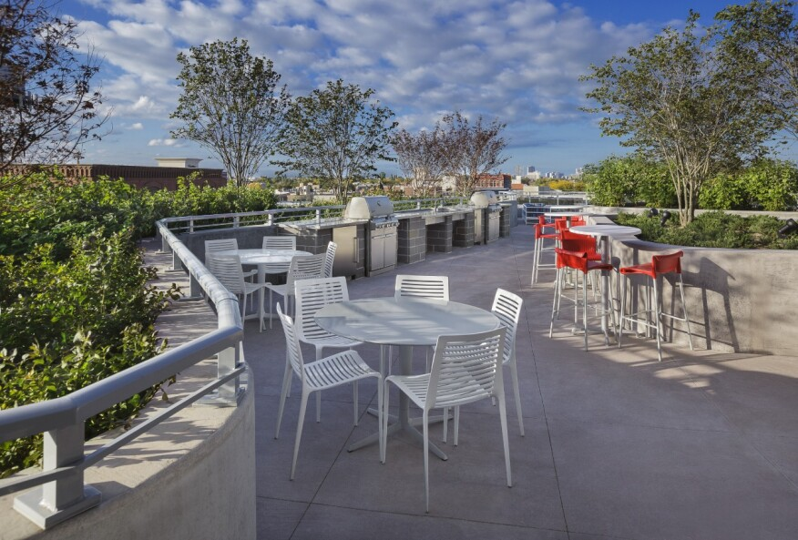 Inviting outdoor amenities at NewCity include a grilling area and a lounge with fire pit.