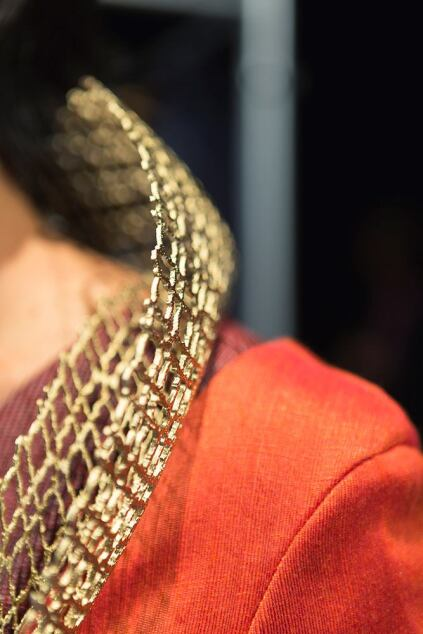 A close-up of the 3D-printed gold collar in HOK's George Washington-inspired outfit.
