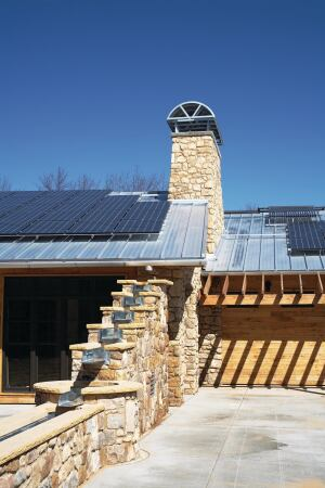 A 39-kWh solar photovoltaic array on the roofs produces more than 61,000 kWh of electricity annually. The roof design bounces natural light into the interiors, reducing the need for electric light, while the overhangs are constructed to shield sun in the summer and allow passive gain in the winter.