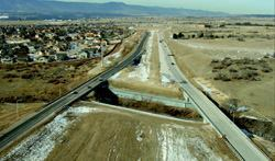 This test section of Powers Boulevard in Colorado Springs, Colo., shows concrete  on the right (northbound) and asphalt on the left. Baseline information  collected so far includes rut measurements, crack mapping, and skid testing. Photo: Gregg  Gargan, CDOT