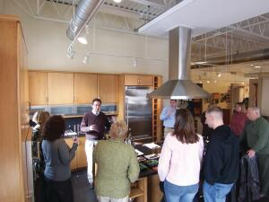 During Rhode Island Kitchen & Bathís Visiting Chefs series, guests and walk-ins learn about the company, cooking, and wine as well as about kitchen products and design.