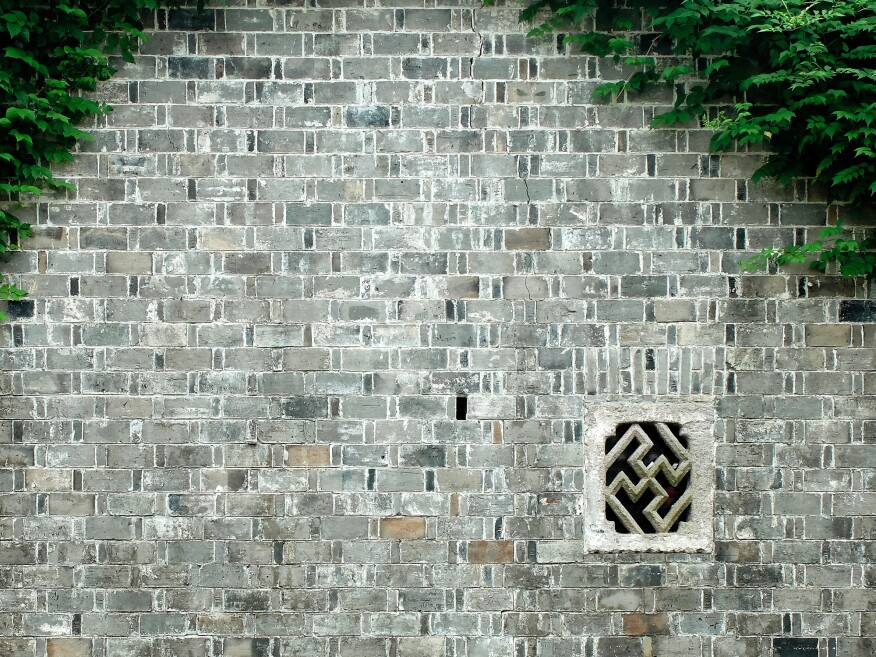 A traditional masonry wall for a residence in Zhejiang, Hangzhou, is the precedent for constructions like Building 15's permeable wall (shown above).