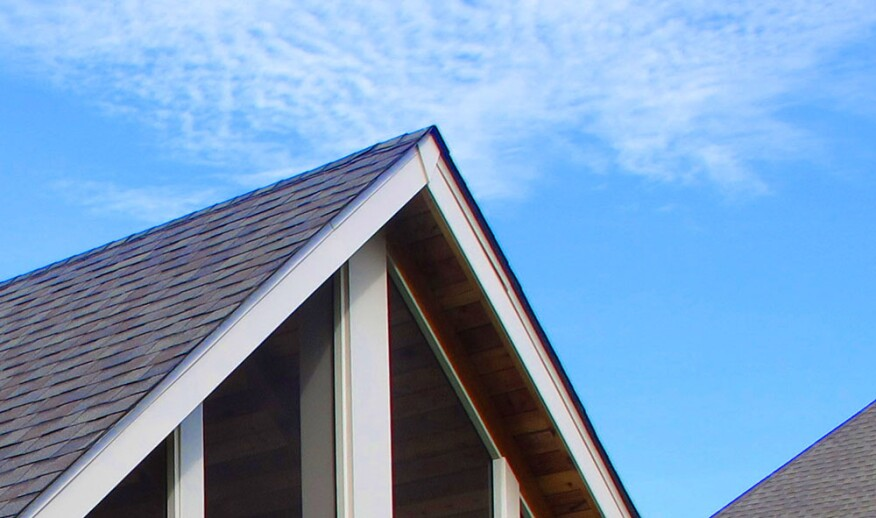 The chevron-shaped piece of decorative trim at the peak of this porch roof conceals the joint between the two pieces of PVC fascia trim, which will open and close with changes in temperature.