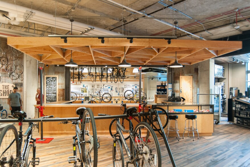 Distinct marketplaces offer a more human-scale environment, such as the bike shop, inspired by the look and layout of a test kitchen.