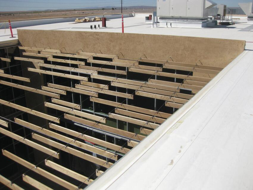 "The unfinished, knot-free, grade A-and-better western red cedar slats provide warmth while its FSC certification contributed toward the project's LEED Silver rating. ""If this were humid Austin, we might have chosen a tropical hardwood, like Ipe,"" Speck says. ""But Albuquerque is dry, and wood does fantastic there. It weathers beautifully and lasts forever."" The slats are 5-, 10-, or 15-feet long. They attach to the cables with #4, ¼-inch, rubber-lined, stainless cushion clamps ordered from the Suncor Stainless catalog."