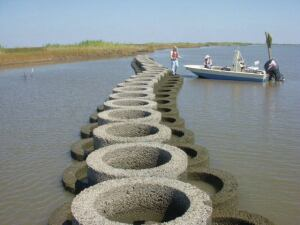 OysterBreak is a proprietary precast concrete system that provides shoreline erosion control using artificial oyster reefs.