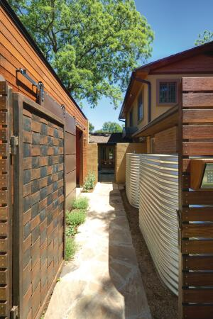 Two corrugated steel cisterns are hidden from street view along one of the home's entryways. Each cistern stores 1,000 gallons of rainwater that is used to tend landscaping and a vegetable garden.