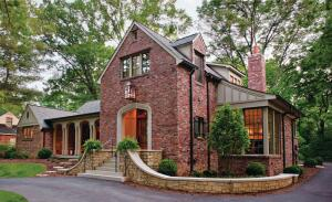 "Swooping In Designer Ridley Wills incorporated details such as the swoop on the end of the front gable into the new front addition as well as in the rear above the basement entrance. ""It gives a cottage feel to the design and softens the gable,"" he says."