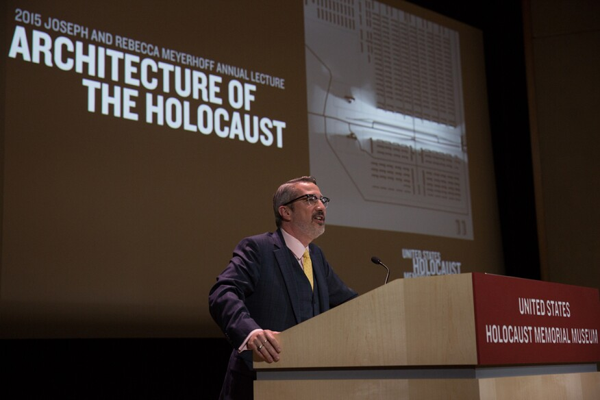 Jaskotdelivering the Joseph and Rebecca Meyerhoff Annual Lecture at theUnited States Holocaust Memorial Museumin Washington, D.C. The image behind him is a viewshed visualization byChester Harvey that shows what a guard could see from theramp of Auschwitz-Birkenau.