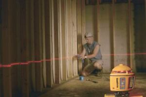 Going straight: Laser level lines take the guesswork out of where to drill for wire, pipe, and tubing--all of which go in easier through a straight run of holes.