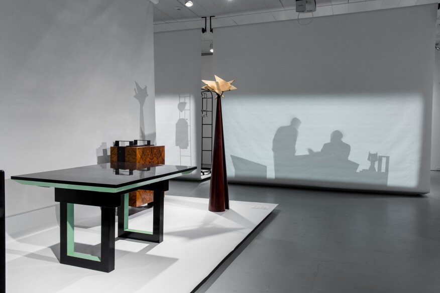Image of the exhibition showing a bicolor table designed by Chareau (1927)