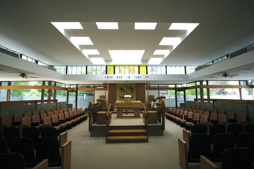 The centralized plan of the main sanctuary on the second floor is lined with floor-to-ceiling windows.