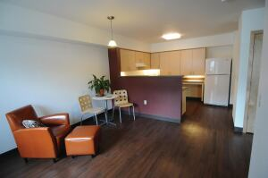 Units at The Knoll at Tigard Apartments include such sustainable features as Energy Star appliances and lighting, low-VOC paint, and low-maintenance materials including vinyl plank tile flooring. Ground-floor units have roll-in showers to   comply with ADA standards.