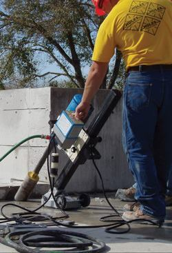 A contractor demonstrates his skills at drilling on an incline (not a test core) in his quest to become certified at a course recently sponsored by the Concrete Sawing and Drilling Association. Using proper drilling techniques is important for an accurate sampling.