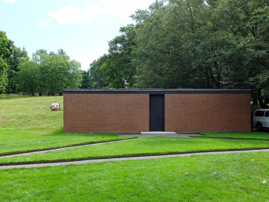 A view of Philip Johnson's Brick House, the Glass House's opaque companion.