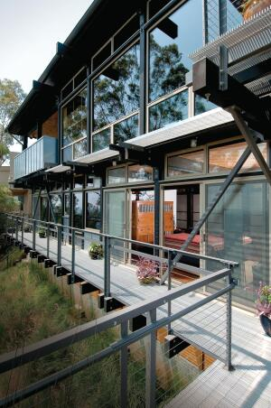 Strict new fire codes had California architect Doug Ewing searching for alternatives to wood decking. For this project, he used metal grates.