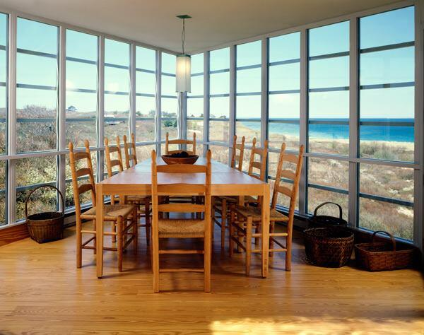 A glass-enclosed dining room afforded views of the sea.
