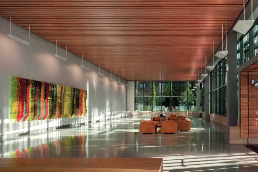 The lobby, with its terrazzo floors and ceilings from 9wood, is lined with floor-to-ceiling glazing from Viracon.