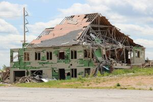 A family sheltered in the basement of this shattered building during the 2011 Joplin, Mo., tornado.