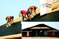 A crew papers the roof of a new home under construction near Gulfport, Miss.