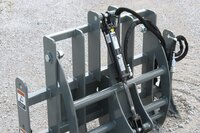 Grapples for miniature loaders, tool carriers
