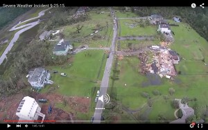 A still frame from flyover video taken by Charleston County after the tornado shows minor cosmetic damage to nearby homes, including the innovative SIP house at lower left, while one house built in 1999 is completely destroyed.