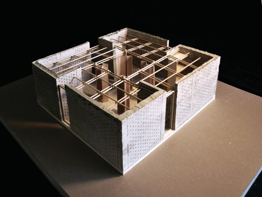 Low-Cost Maze The prototype's interior is a series of L-shaped earthen-block walls.