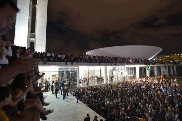 Protesters gather at the Brazilian National Congress building in Brasilia, Brazil, on Monday, June 17, 2013.