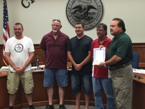 Litchfield, Illinois Mayor Steve Dougherty (far right), presented a proclamation to American Water Contract Services employees (left to right) Andrew Bowns, Terry Hancock, Michael Martin and Allen Burger during the July 21 city council meeting. The employees of the Litchfield, Ill. facility, are celebrating 20 years without a recordable, lost-time accident.