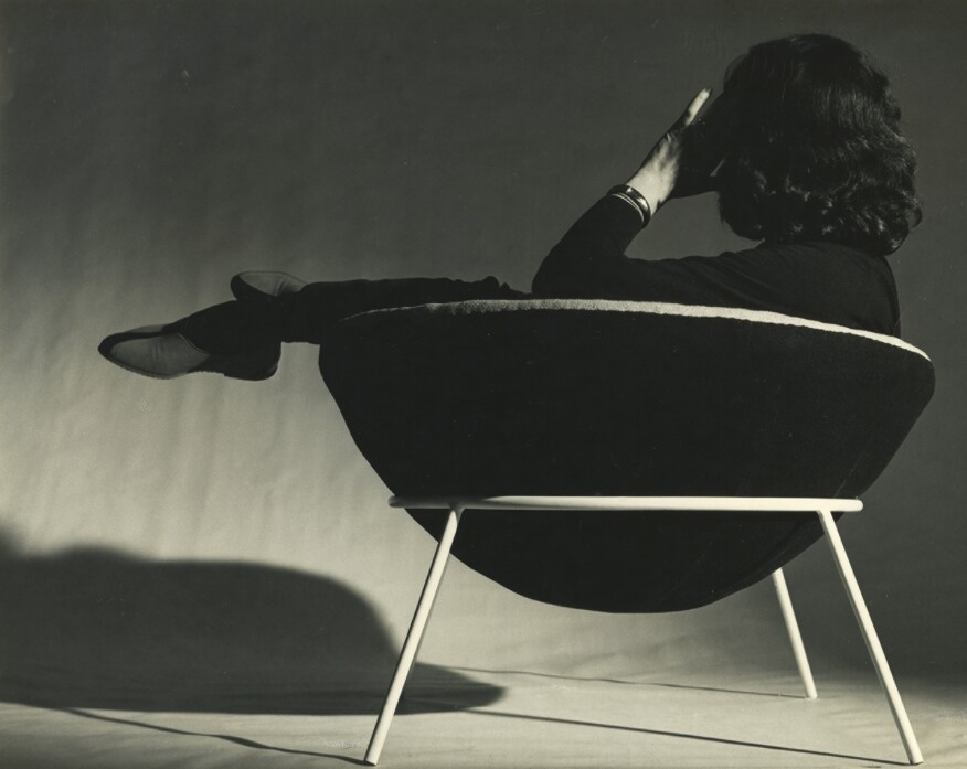 Lina Bo Bardi lounging in her iconic Bowl Chair.