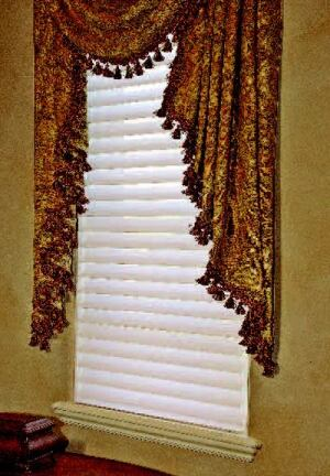 "WINDOW TREATMENT: Custom window fashions by Hunter Douglas create a sense of privacy in the home. Silhouette (in  the master bedroom) features Toujours fabric suspended  between sheer panels and has an UltraGlide single-cord lift system. The boy's  room has Provenance woven wood shades. And Duette shades in various areas  of the house ""trap"" air in honeycomb pleats, insulating against  heat loss in the winter and heat gain in the summer."