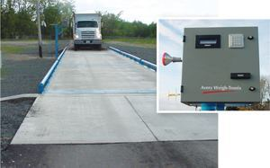 Installed on an aboveground pier-type foundation, the scale's low profile allows drivers to access the console (inset) from the truck. Dr Drivers know they're too close to the edge if they hear the tires rub against the welded-on guide rails. Photos: Avery Weigh-Tronix Inc.