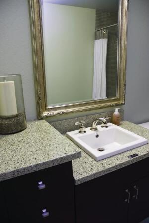 Vetrazzo's recycled-glass countertops in cubist clear top the bathroom vanities.