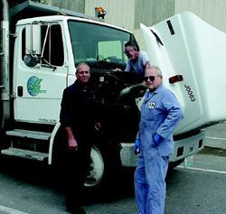 From left, Don Baker, maintenance technician; Mike Shullenberg, equipment service  specialist, and John Culley, senior maintenance technician, work on a  dump truck in Everett, Wash. Due to improved maintenance, the average age  of these trucks rose from 6.55 years in 2001 to 8.5 years in 2005. Photo: City  of Everett, Wash.