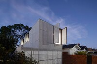Perforated Shutters Animate the Facade of This Residence