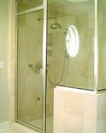The shower has glass panels that fit from floor to ceiling to create  a tight box for a steam unit. The stone floor is heated for a truly luxurious  touch. Remodeler Erik Anderson offers the option to all his clients.