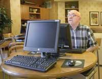 GET CONNECTED: Seniors can check their stock portfolio or play computer solitaire at La Vida Real's Internet lounge.