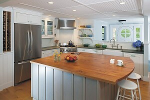The client wanted a kitchen with a vintage feel that also fit with the ocean views of this Cape Cod vacation home.