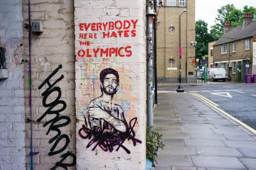 "London 2012  Street art in Hackney Wick, a working-class, East London neighborhood where part of the Olympic Park was sited, offers a blunt take on the Games. Anti-Olympic sentiment among street artists came to a head in July 2012, when British Transport Police arrested four ex-graffiti artists ""on suspicion of conspiracy to commit criminal damage."" For his part, Bansky, the world-famous graffiti artist, had critiqued Britain's increased military presence for the Games with ""Hackney Welcomes the Olympics,"" an image of a javelin thrower hurling a missile."
