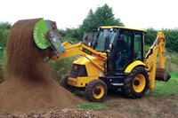 Rotating aggregate screen for heavy equipment