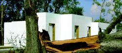Hurricane Rita hit when this Beaumont, Texas, house was half built. Trees fell and houses were knocked down, but the ICF walls stood.