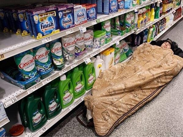 A man sleeps in a grocery store aisle after getting stranded in the Atlanta snow and ice storm.