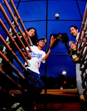 HOME FIELD ADVANTAGE: Jose and Erika Reyes were on the verge of becoming super-commuters, spending  hours a day on Southern California's crowded freeways. Among Erika's biggest  heartaches was telling her 12-year-old son that no one would be able to  take him to baseball practice. Then they heard about The Boulevard, a community  of market-rate, single-family homes and affordable townhomes.